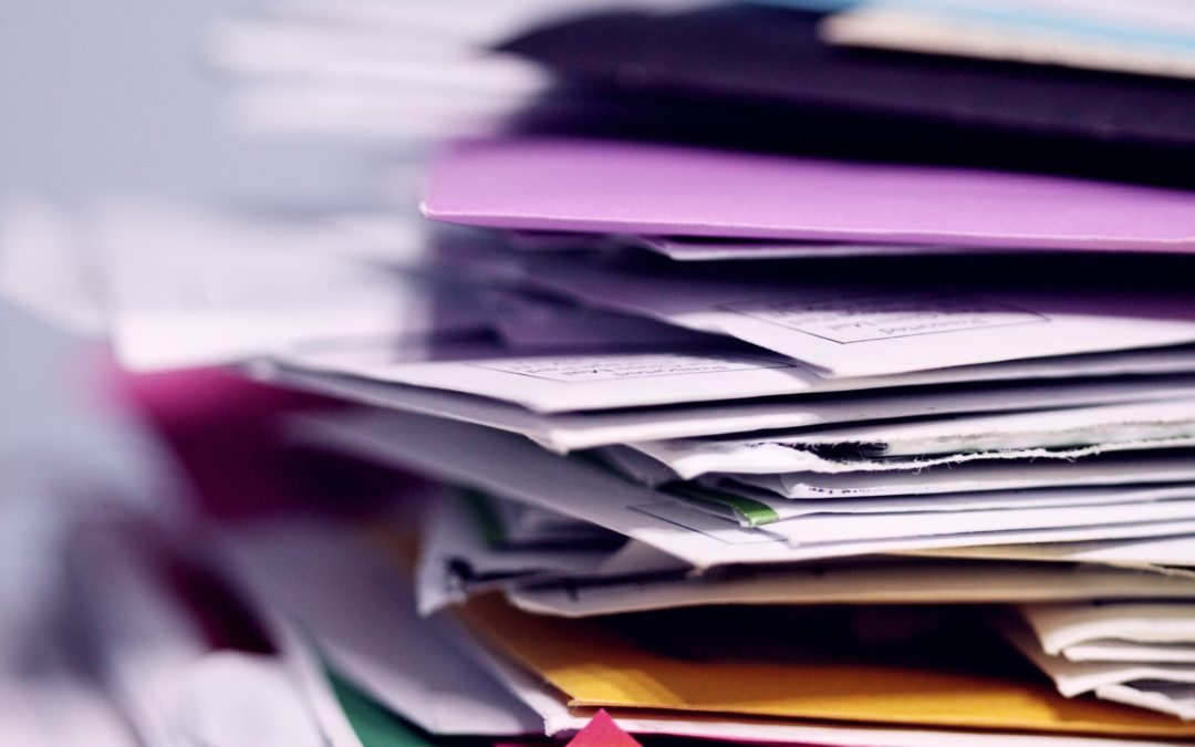 colourful documents stacke on top of each other